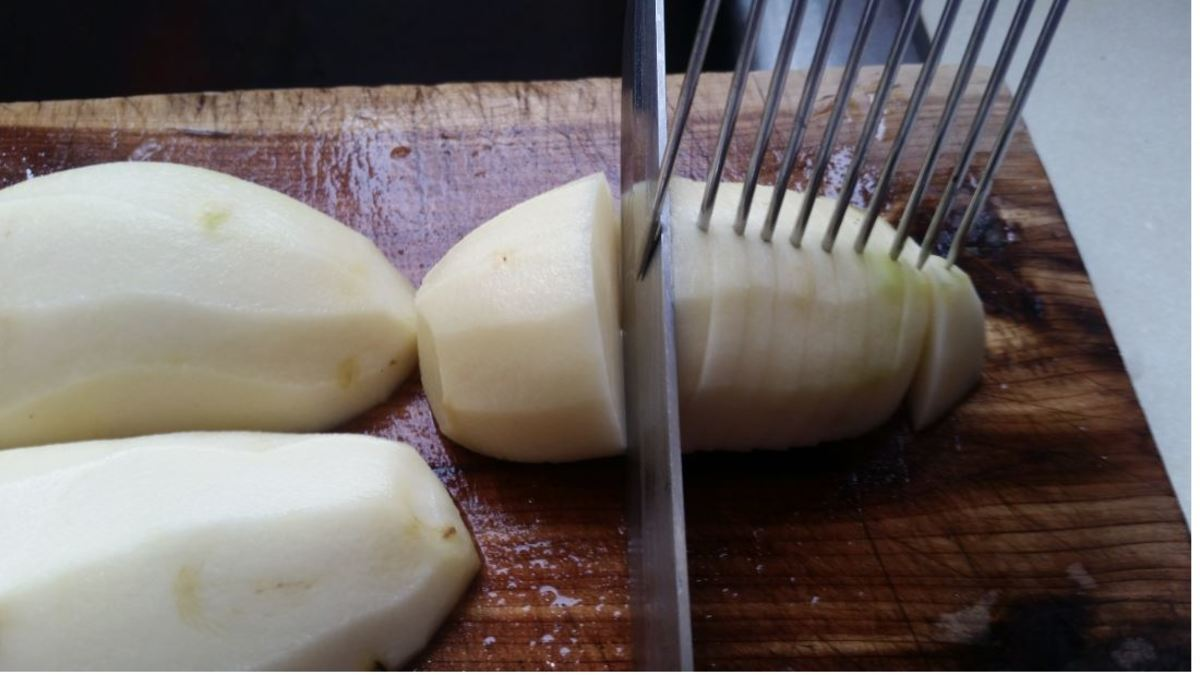 using slicing tool to evenly slice potatoes