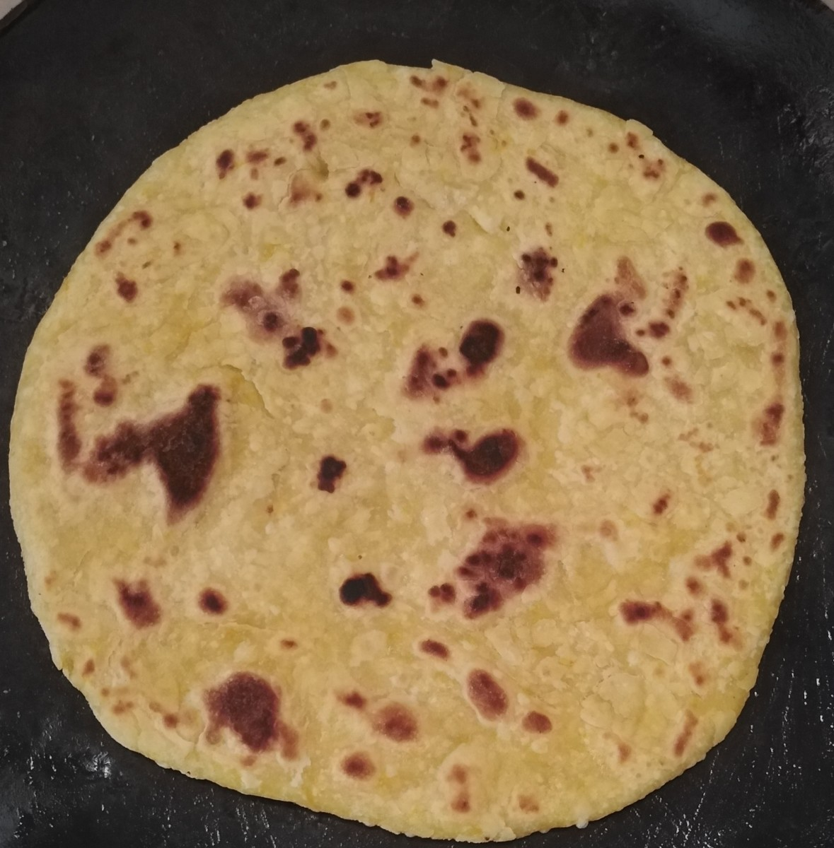 The chapati is cooked. Keep it in a hotpot to keep it warm. If left out in the open, it can harden.