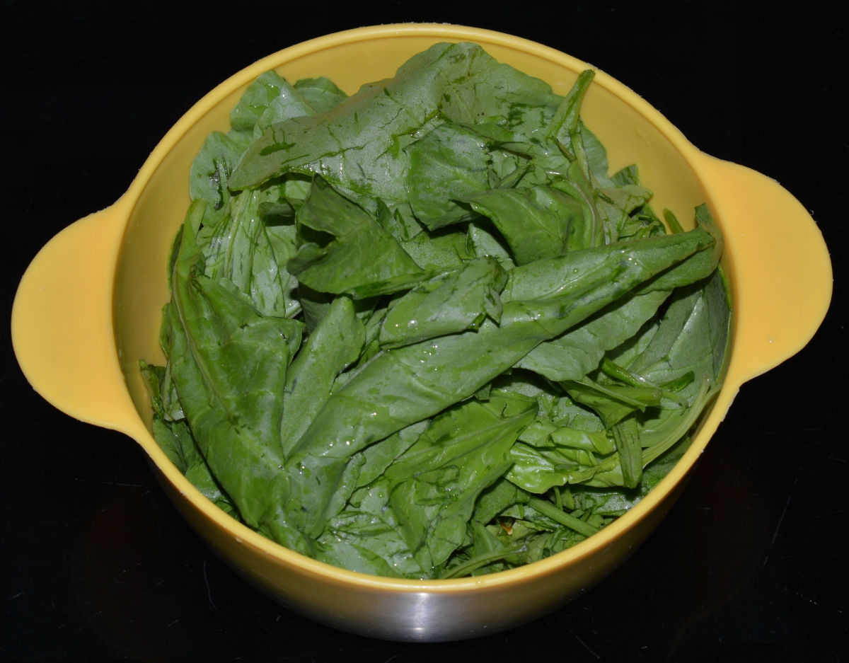 Step one: Wash, remove the stems, and chop the spinach leaves.