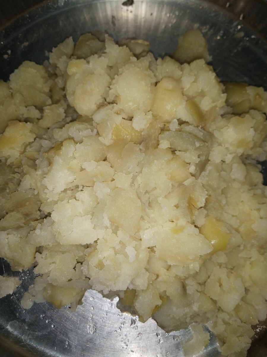Boil the potato, then peel it and mash it. (You can cube it, too.)