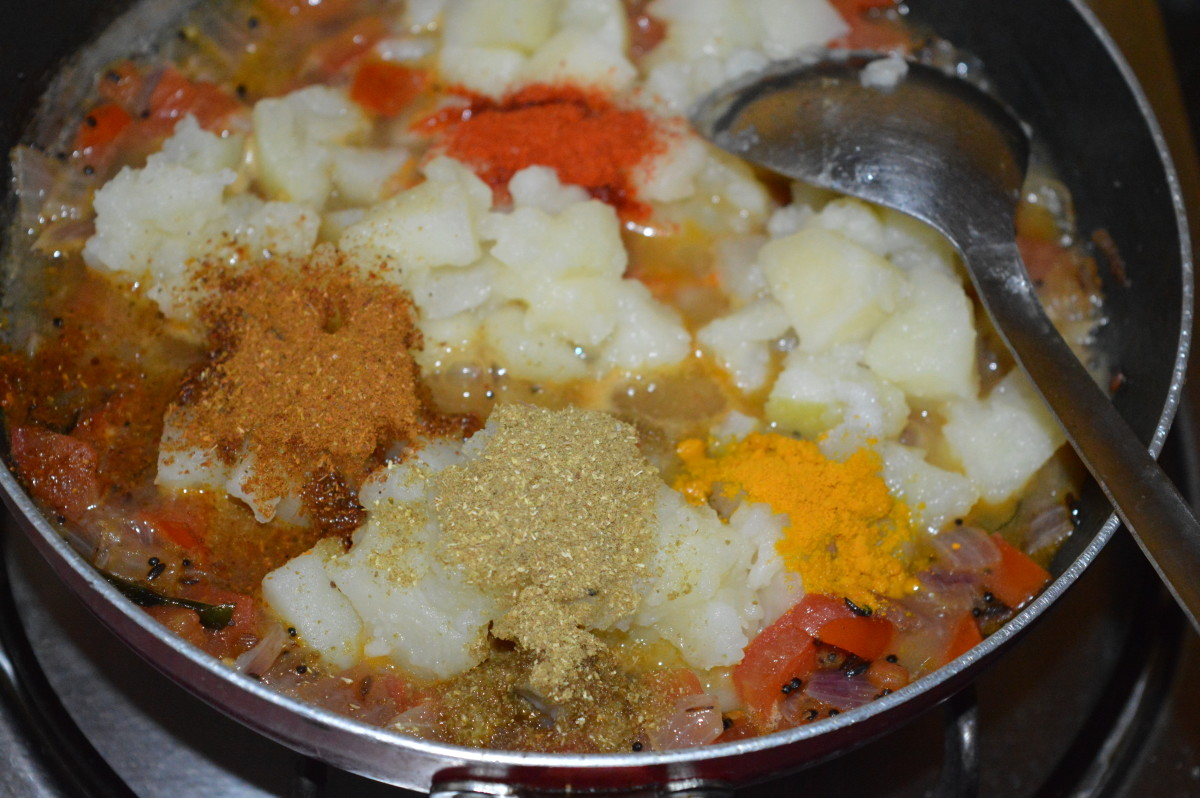 Step five: Add all the spices, remaining salt, and sugar. Mix well and cook for 2 minutes.