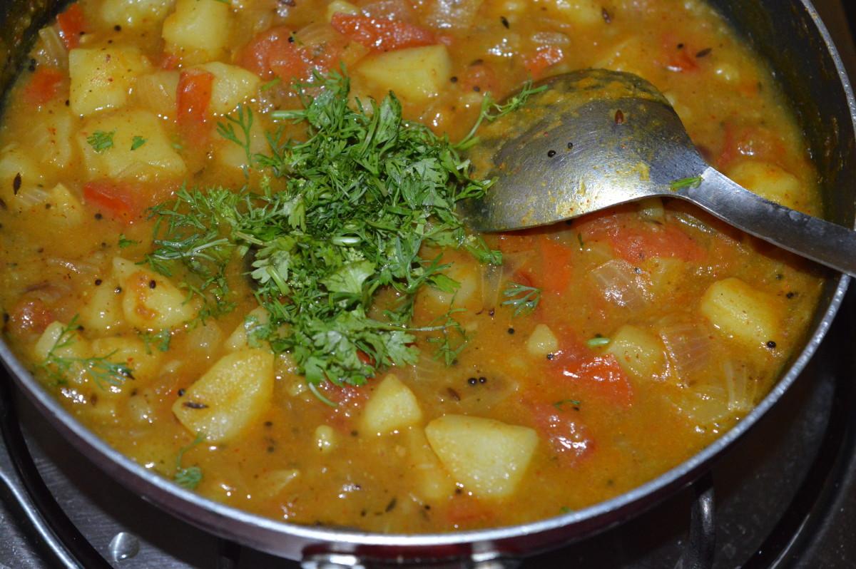 Add chopped fresh coriander leaves. Stir well.