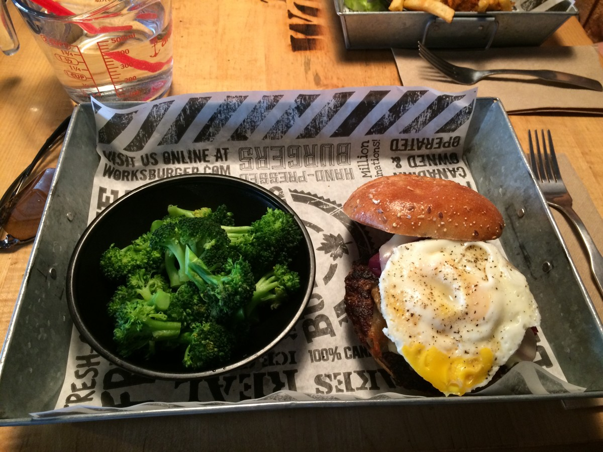 """Down Under"" burger with steamed broccoli"