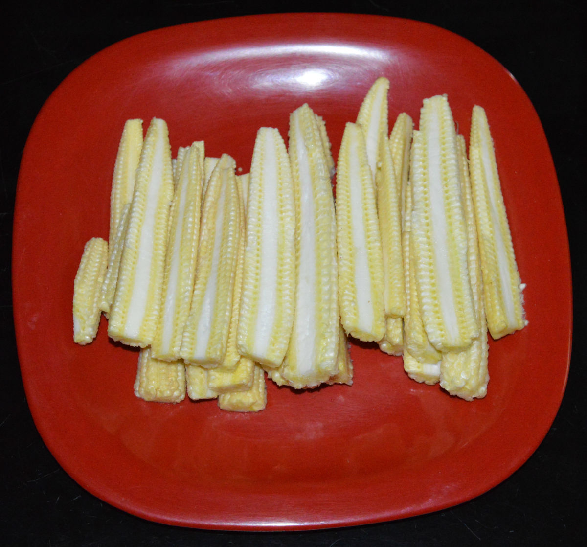 Step one: Wash and slit the baby corn horizontally.