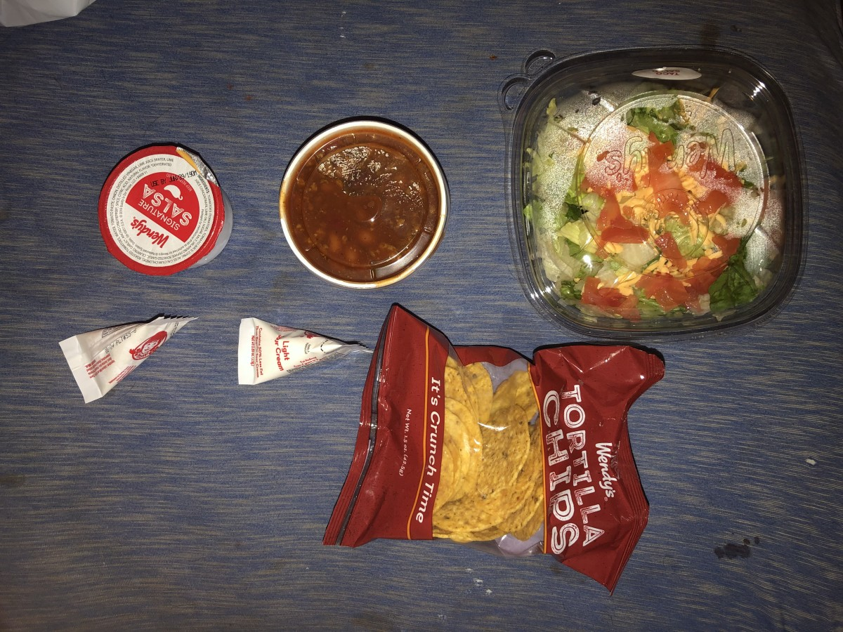 The Wendy's Taco Salad comes with hearty chili, crisp lettuce, and a whole lot more.