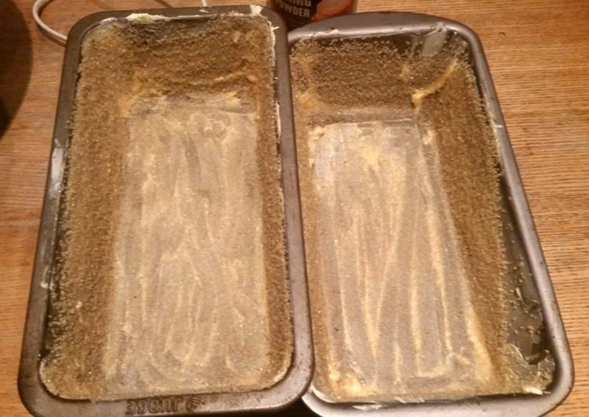 Preparing the loaf tins for banana bread