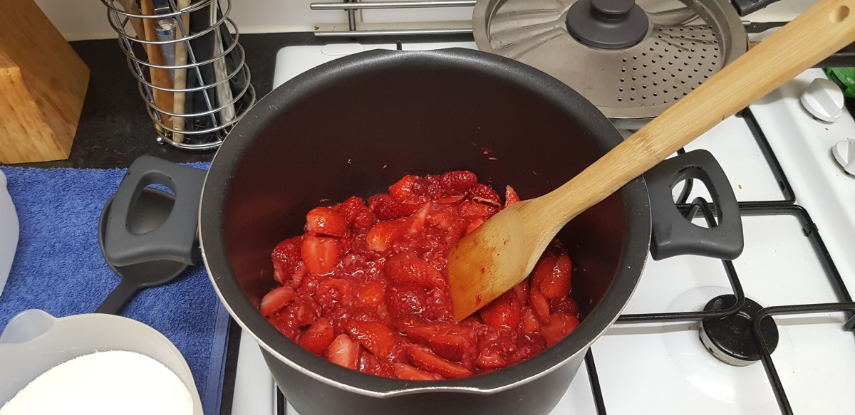 The strawberries and raspberries in the pan before they had started to soften and break down fully.