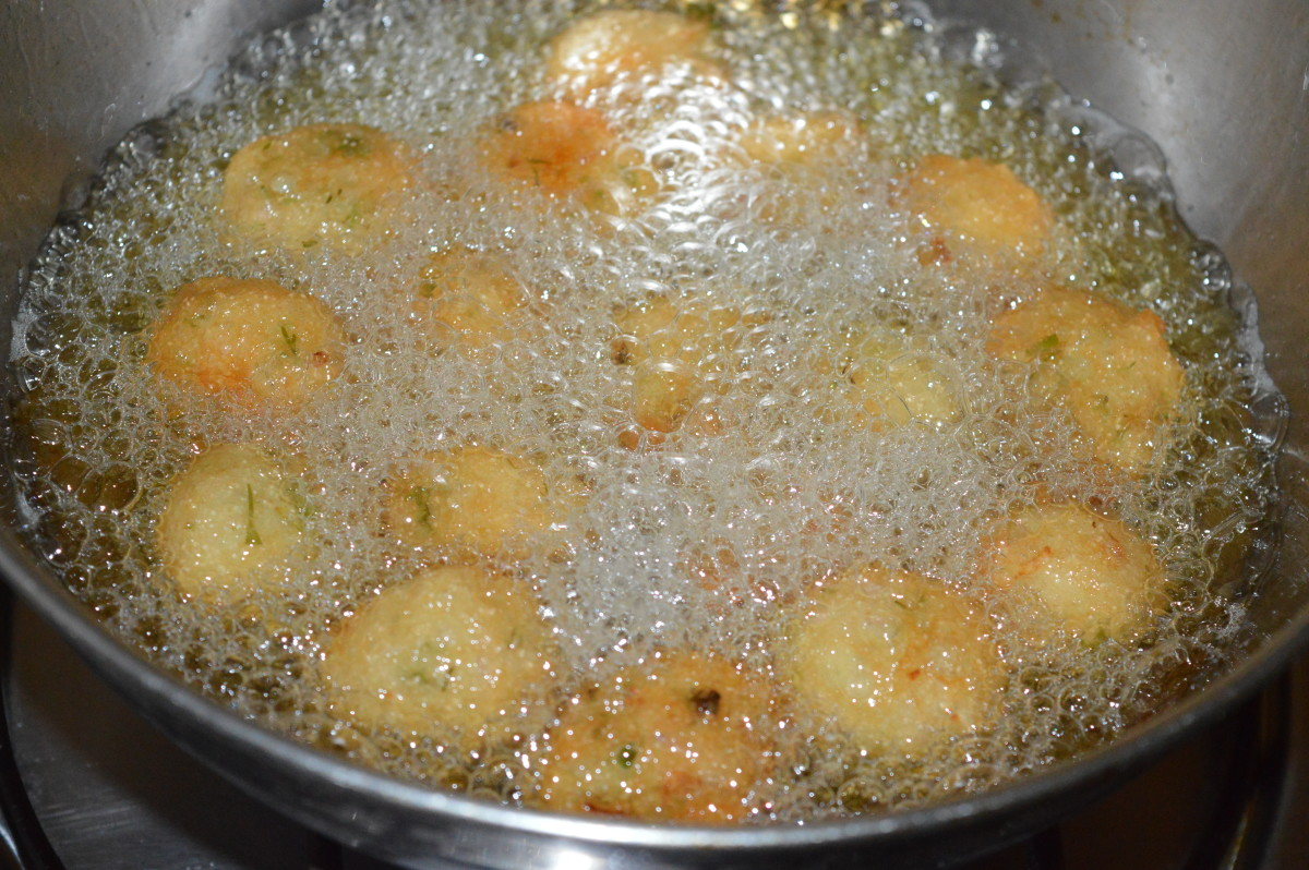 Step two: Heat the oil for deep-frying. Pick up lemon-sized portions of the batter and gently slide them into the hot oil.