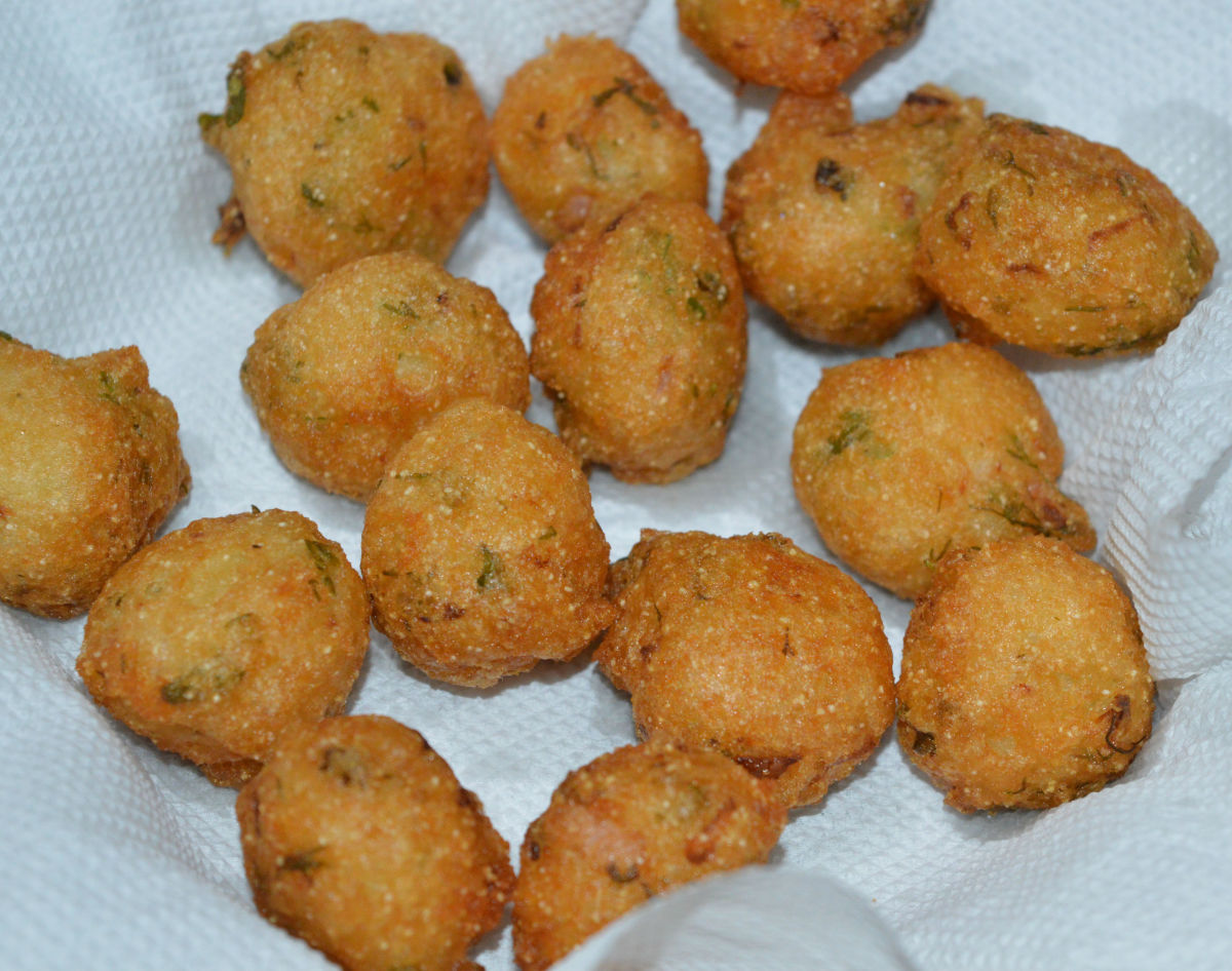 Fry them while turning occasionally. Remove once they turn golden and crunchy. Place them on an absorbent paper towel. The hot idli batter fritters (punugulu) are ready to munch!