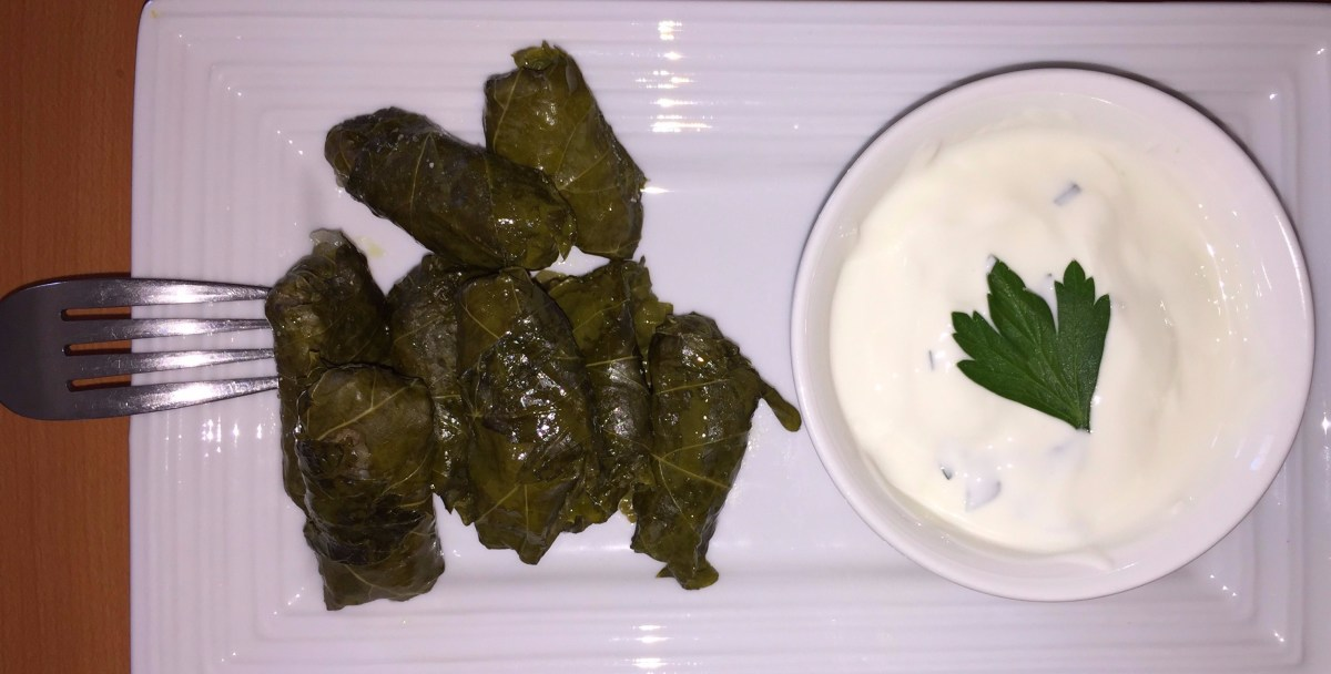 After cooking, serve the dolmades with tzatziki, lemon juice, or even just a dash of salt.