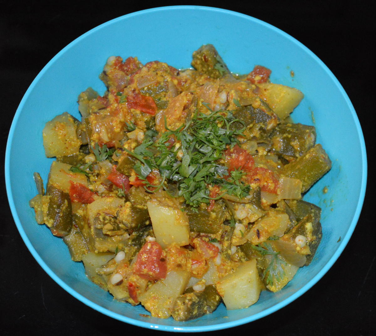 The okra potato curry in a serving bowl.