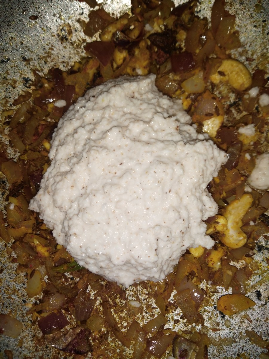 Now add ground paste (coconut and cashew paste).