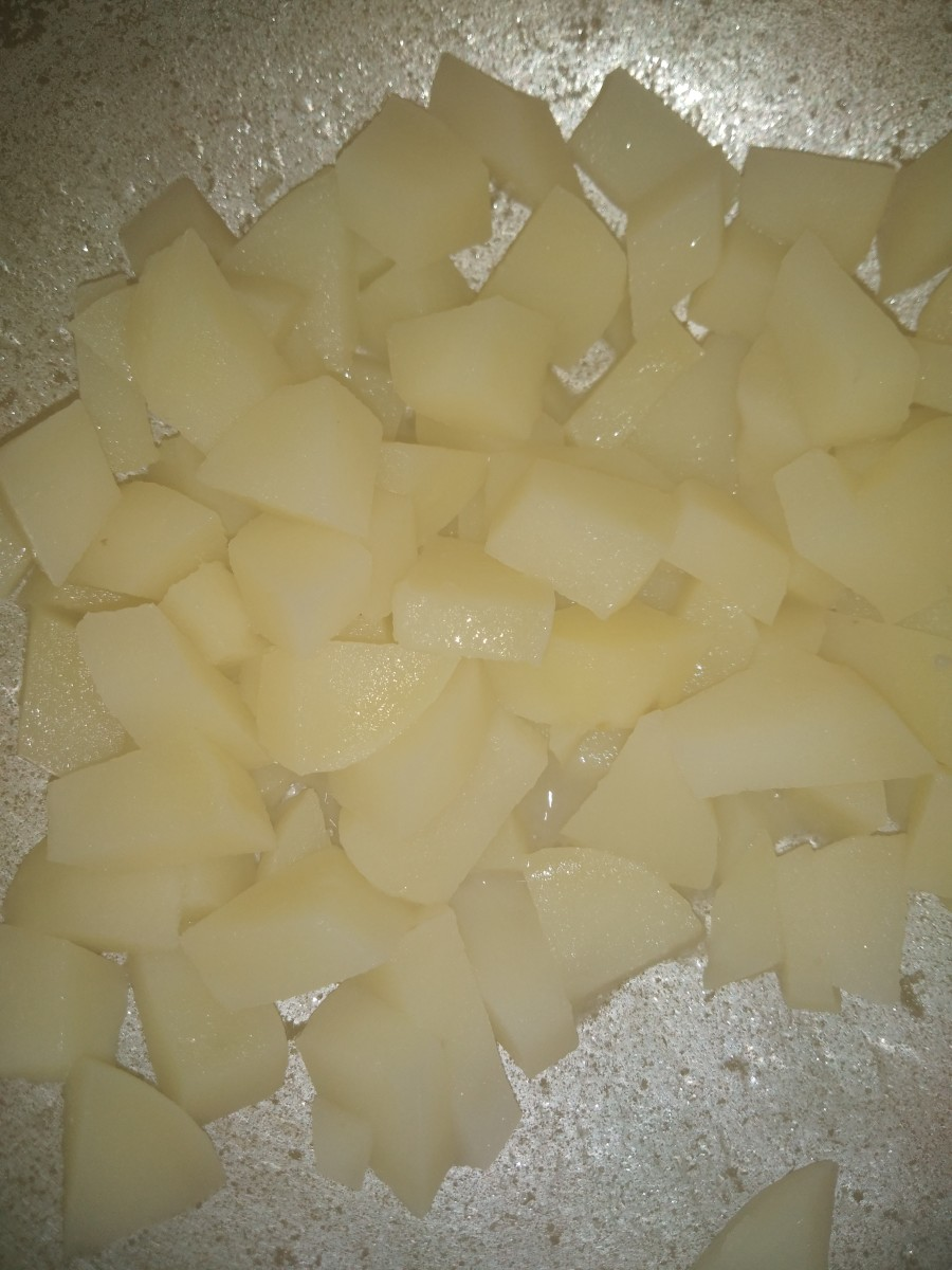 After potatoes are cooked, drain the water and set aside.