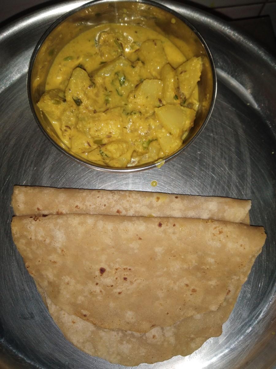 Serve hot with chapati, poori, or rice.