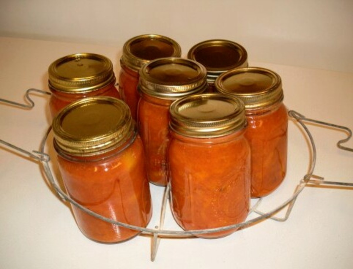 Place in a canner rack or place each in the canner with a jar lifter.