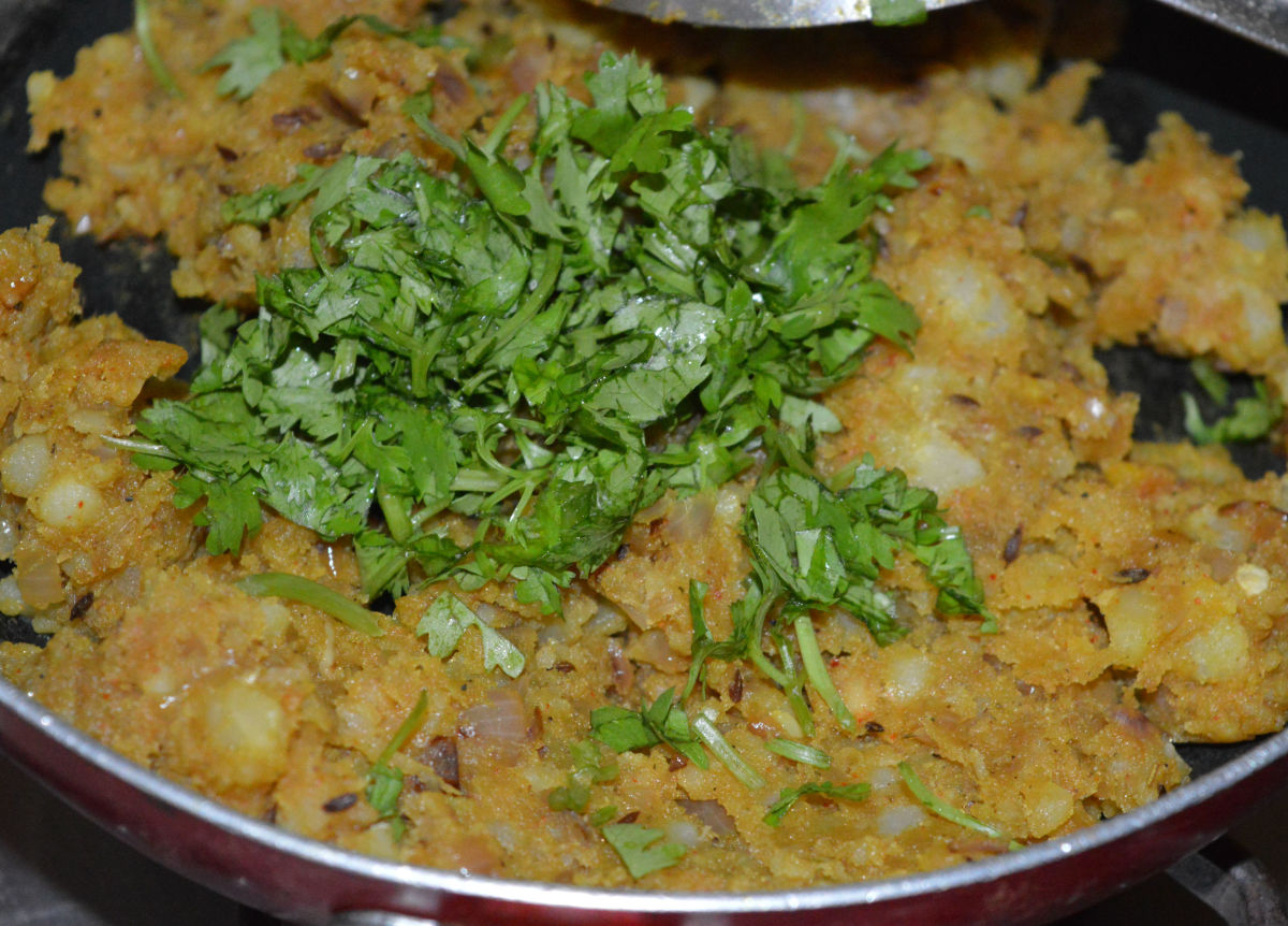 Add finely chopped coriander leaves. Combine with the potato mixture. Turn off the heat. Set mixture aside to cool.