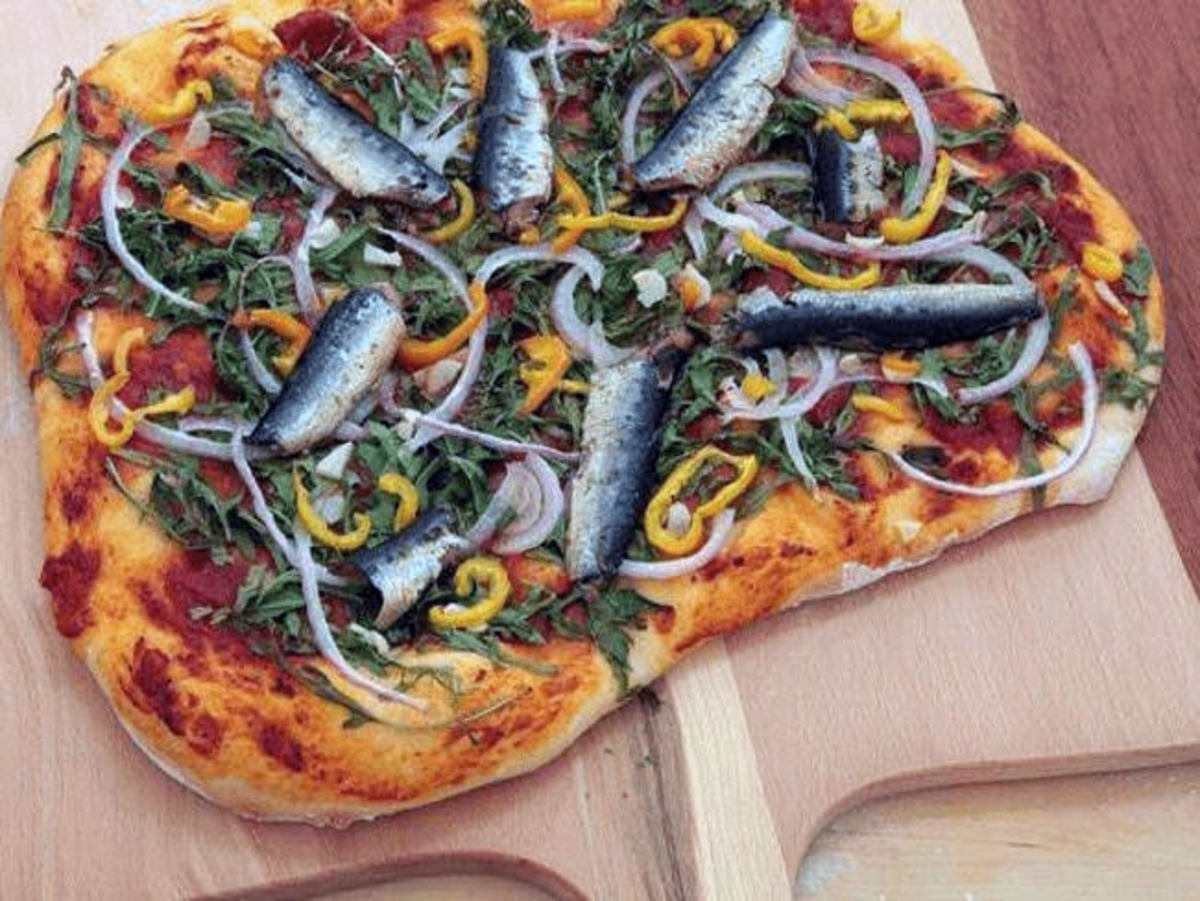 Russia takes fish on pizza to a new level with mockba, a style of pizza that uses mackerel, tuna, sardines, and salmon, along with a heaping helping of onions.