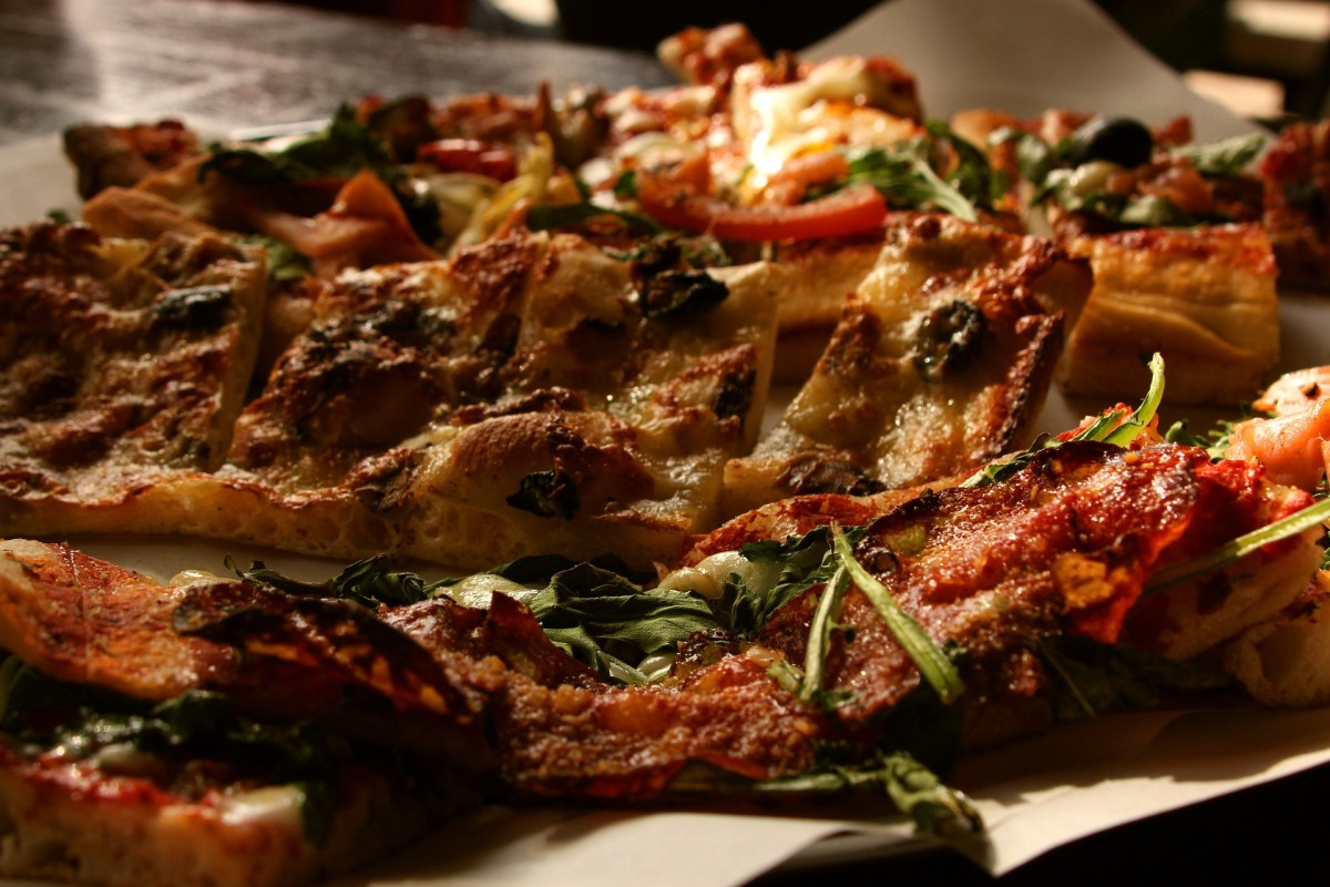 Focaccia, invented circa 700 BC by the ancient Etruscans, is one of the ancestors of pizza that is still eaten today.