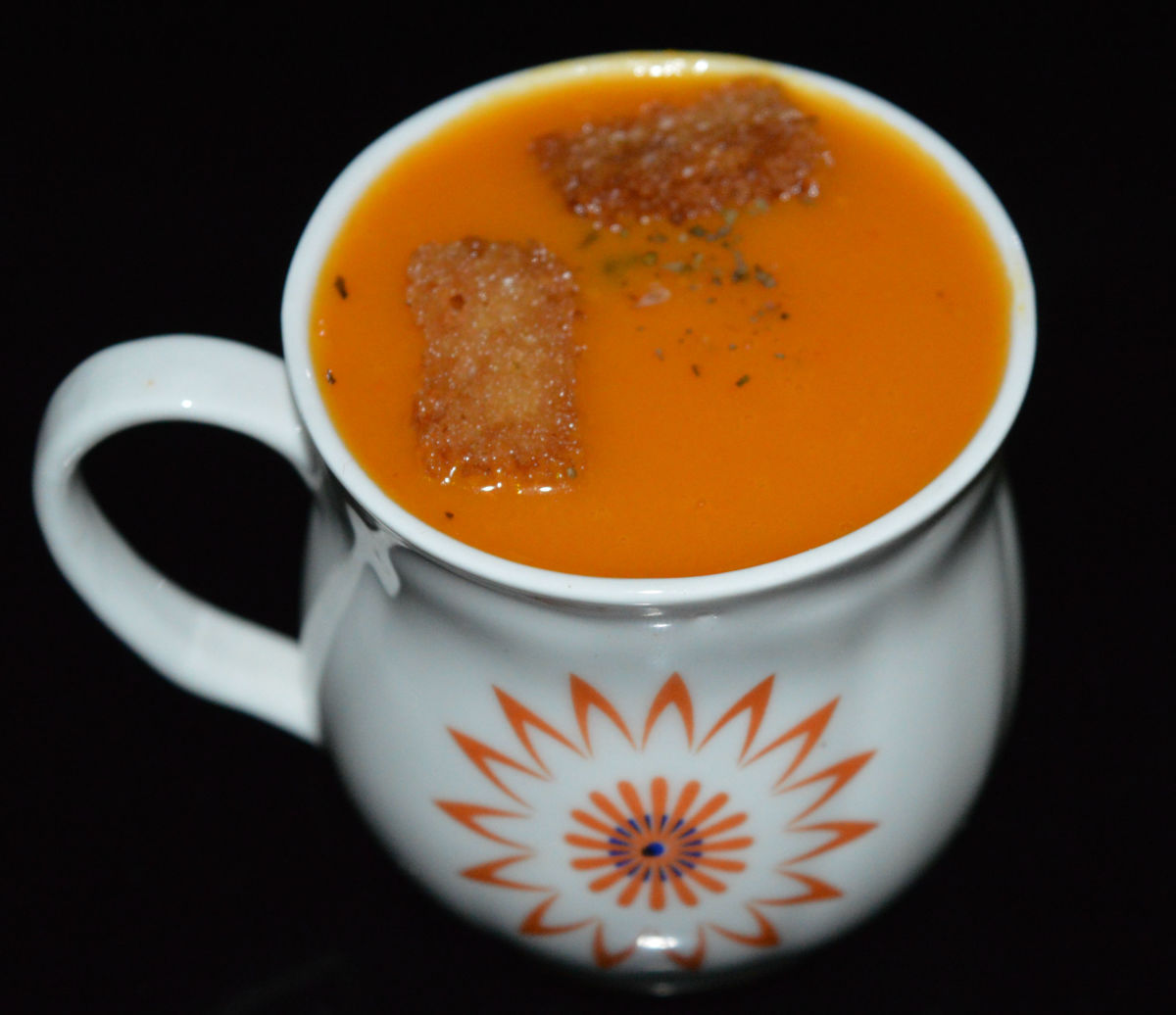 Mouthwatering carrot-onion soup is ready! Serve hot, garnished with toasted bread crumbs or dried herbs. Sip the heavenly puree!