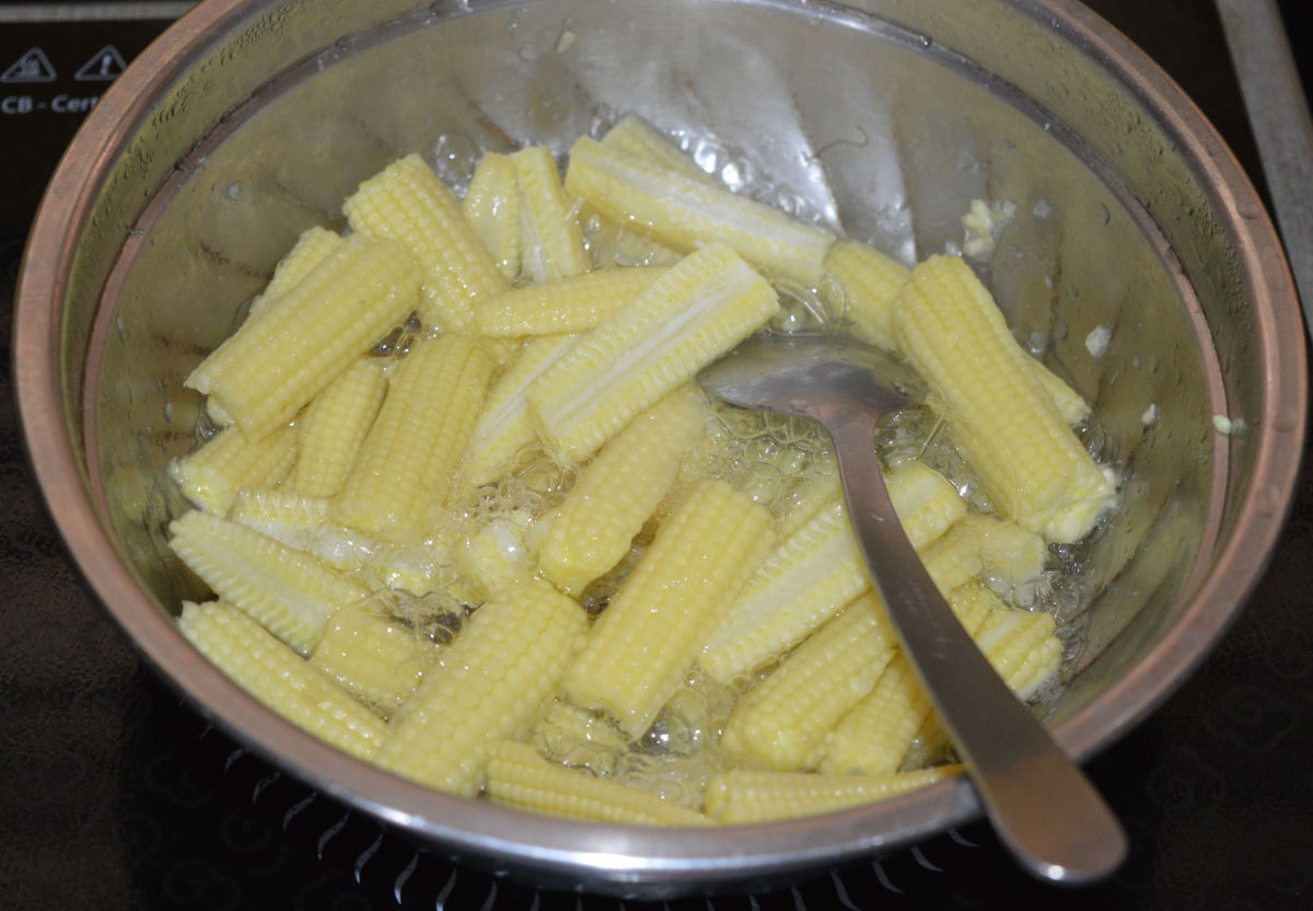 Parboil the baby corn with some salt and water. Set aside.