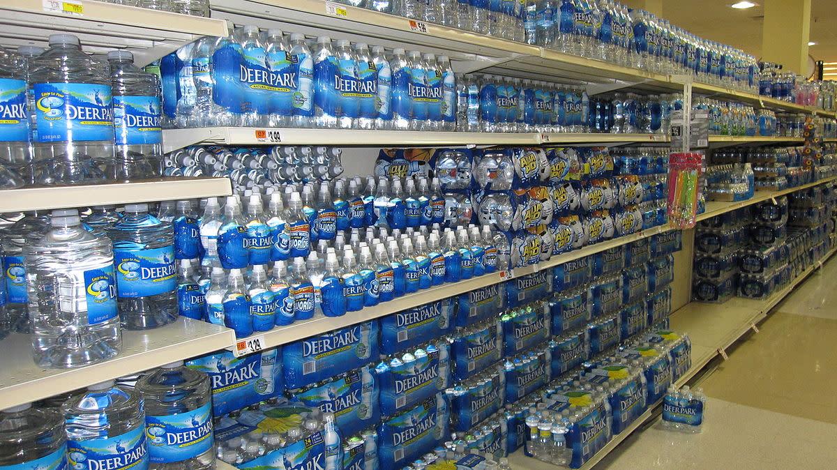Shelves full of bottled water.
