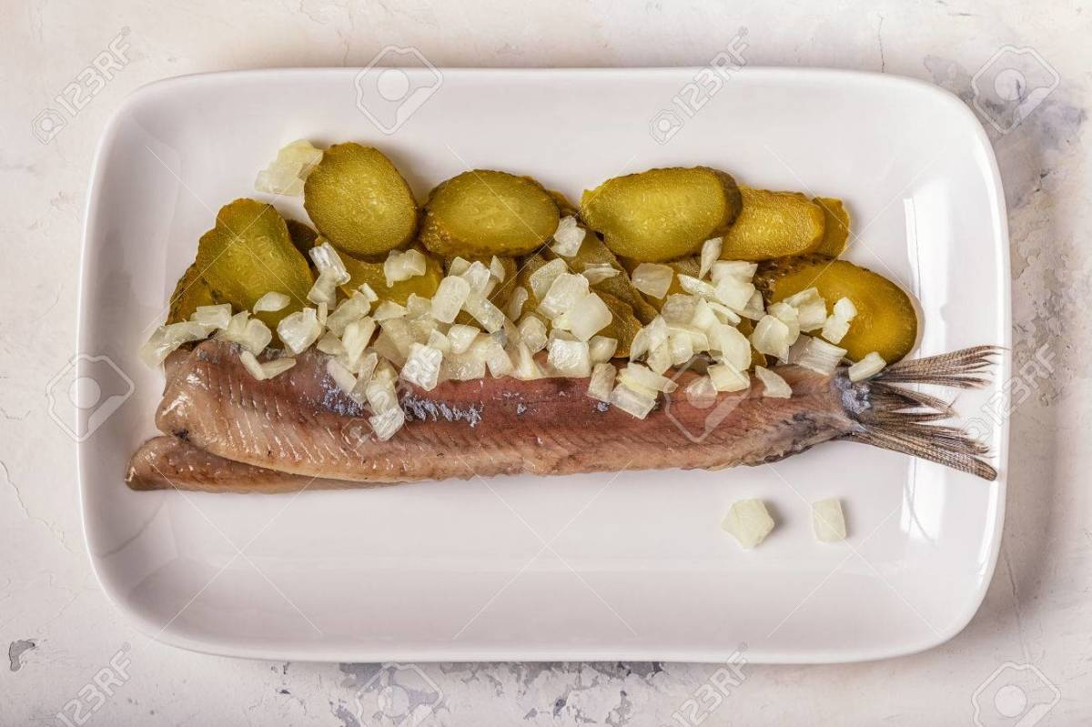 Raw herring with onion and gherkin