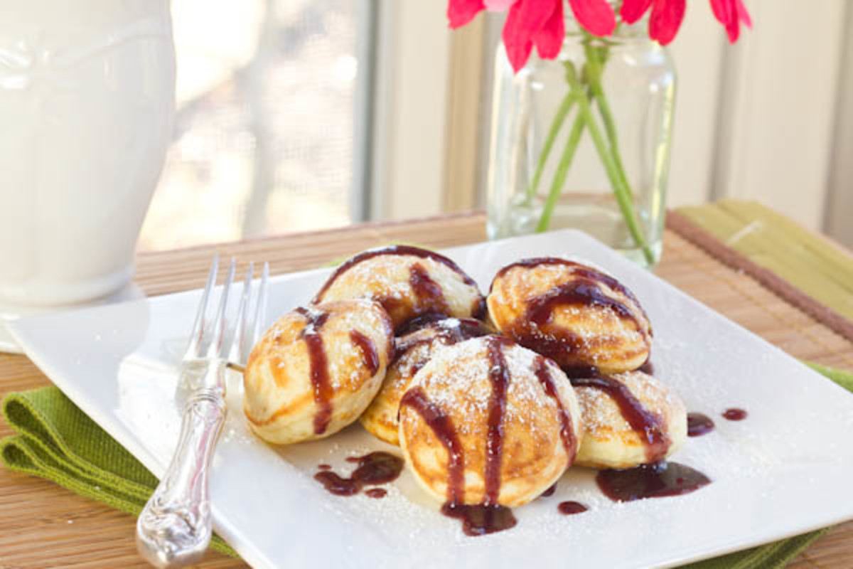 Poffertjes with powdered sugar and chocolate syrup