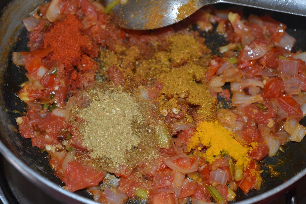 Step three: Add the dry spices: turmeric powder, red chili powder, coriander powder, and garam masala powder. Saute for 1 minute.