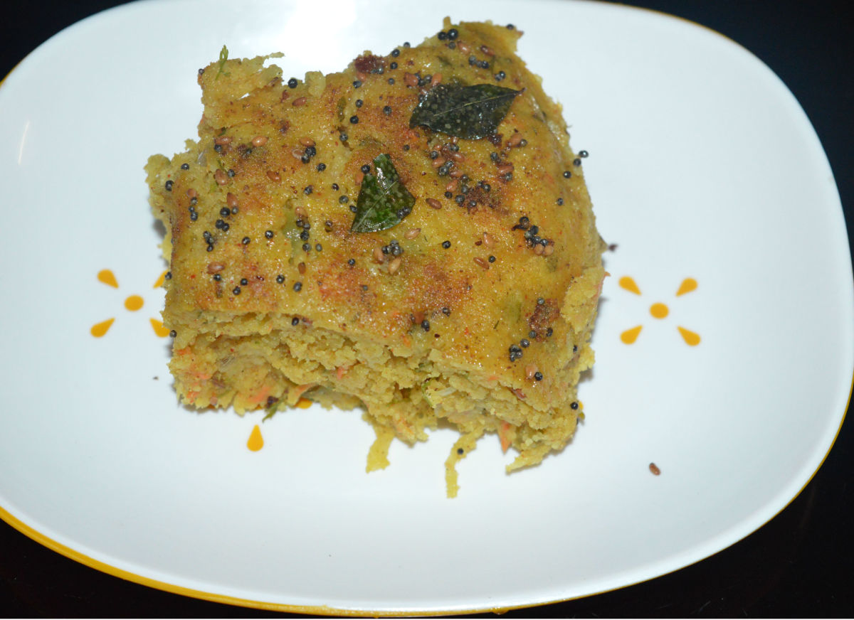 Cut the cake into small pieces. Serve hot with green chutney and tomato sauce. Enjoy eating the spicy and spongy cake!