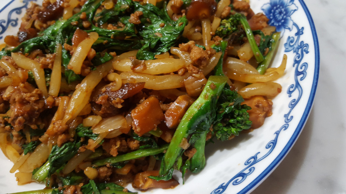 Rice Drops in Dongcai Mushroom Pork sauce. Italian rape as green leafy vegetable.