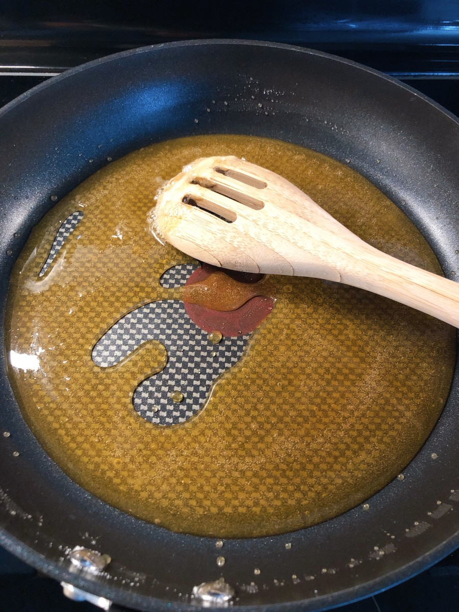 Slowly stir the sugar with a wooden spoon.