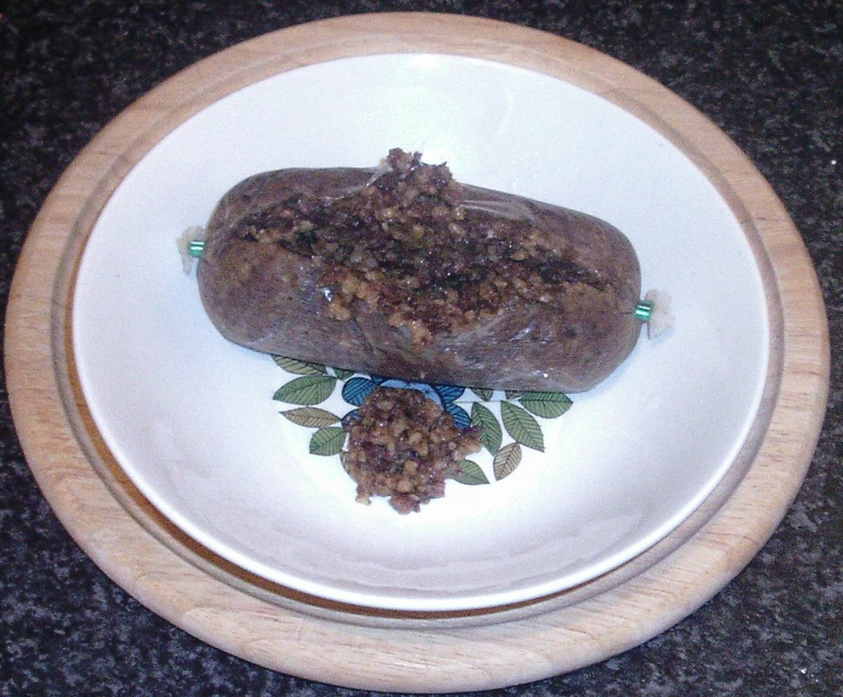 Haggis is carefully cut open for serving