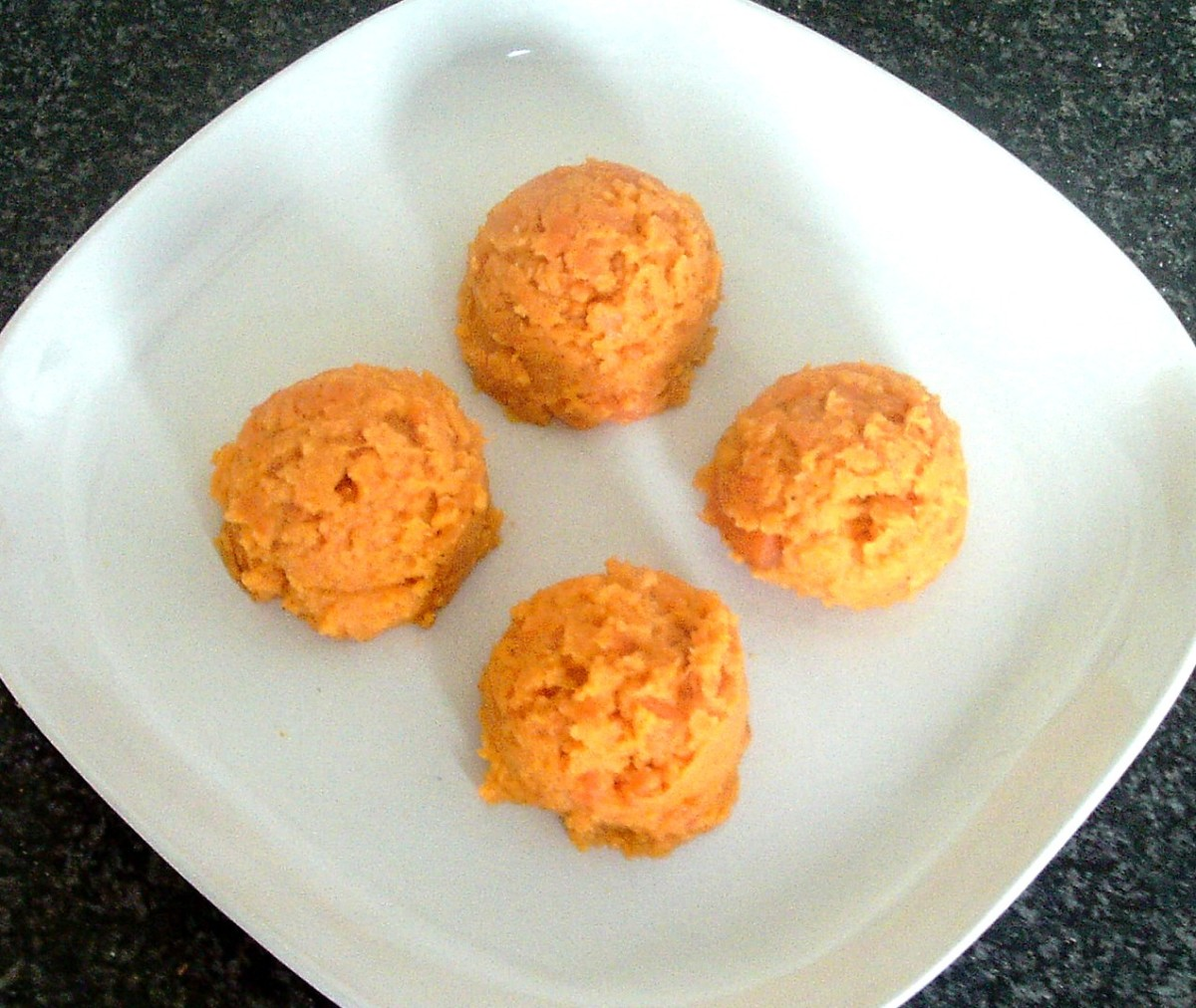 Scoops of sweet potato and carrot on serving plate