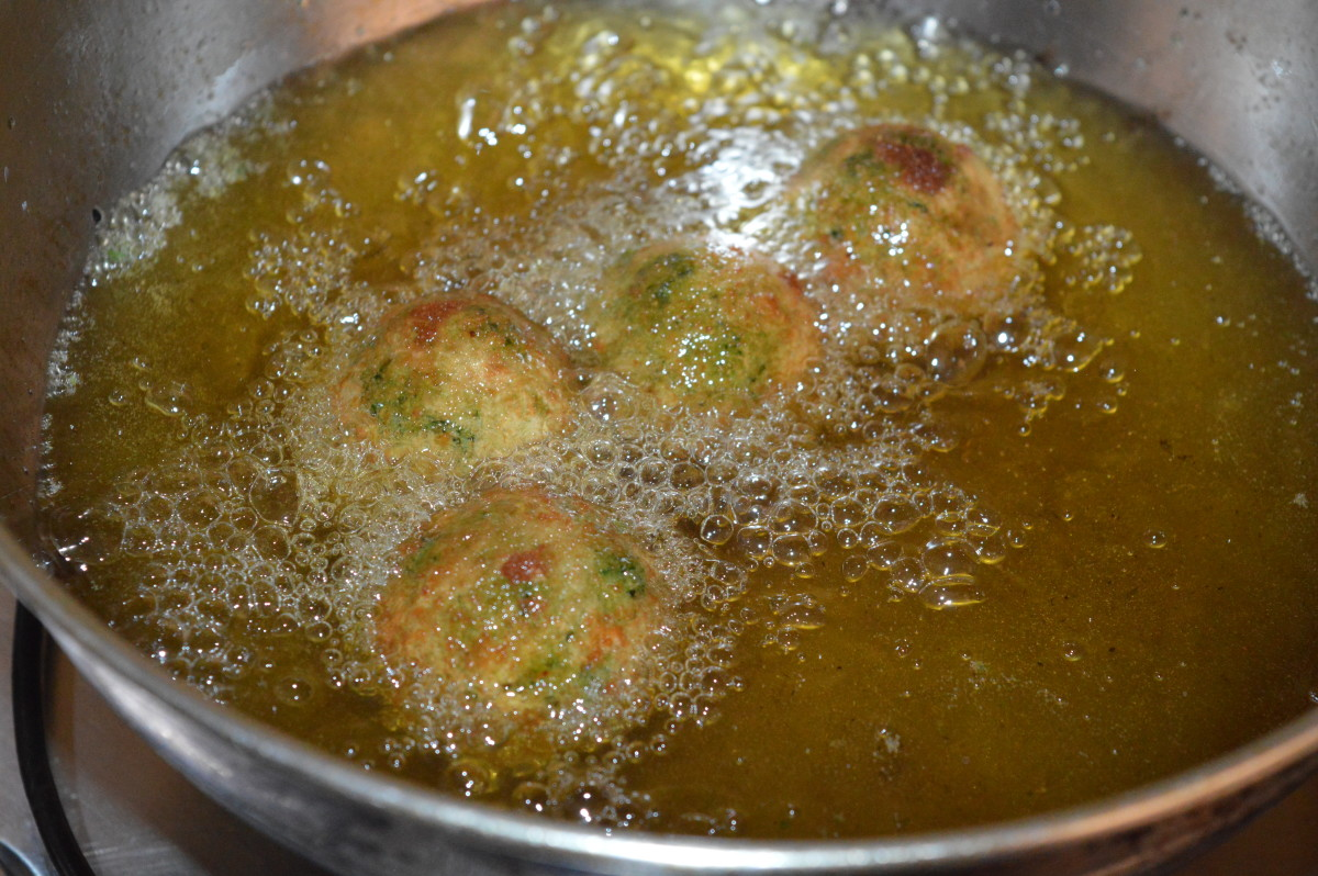 Step six: Heat the oil for deep frying. Gently drop a few balls into moderate hot oil. Don't overcrowd them. Turn them occasionally to ensure uniform frying on all sides. Reduce heat once they become crunchy outside.