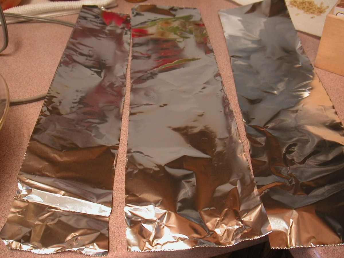 Prepare three narrow strips of aluminum foil to protect the crust from burning.