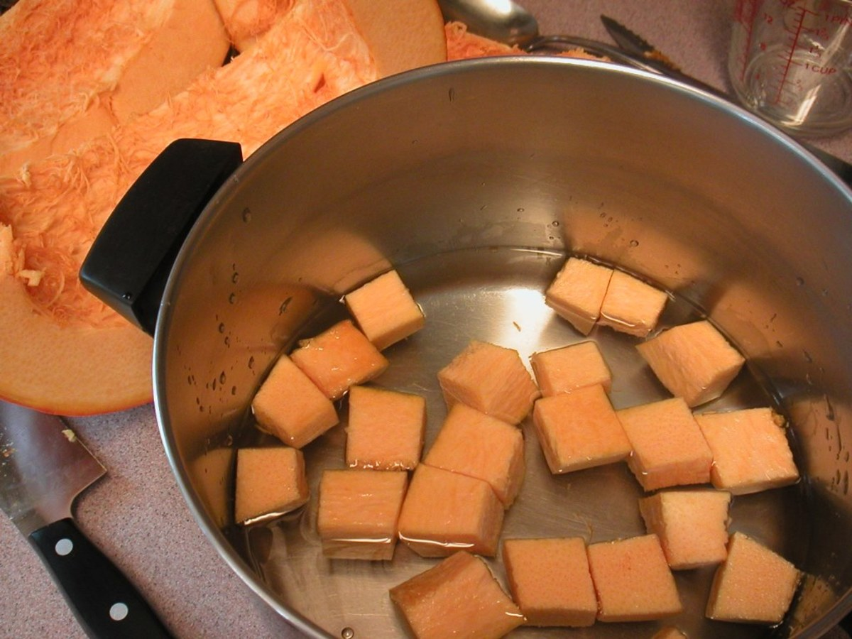 Place the cubes into a deep stew pot.