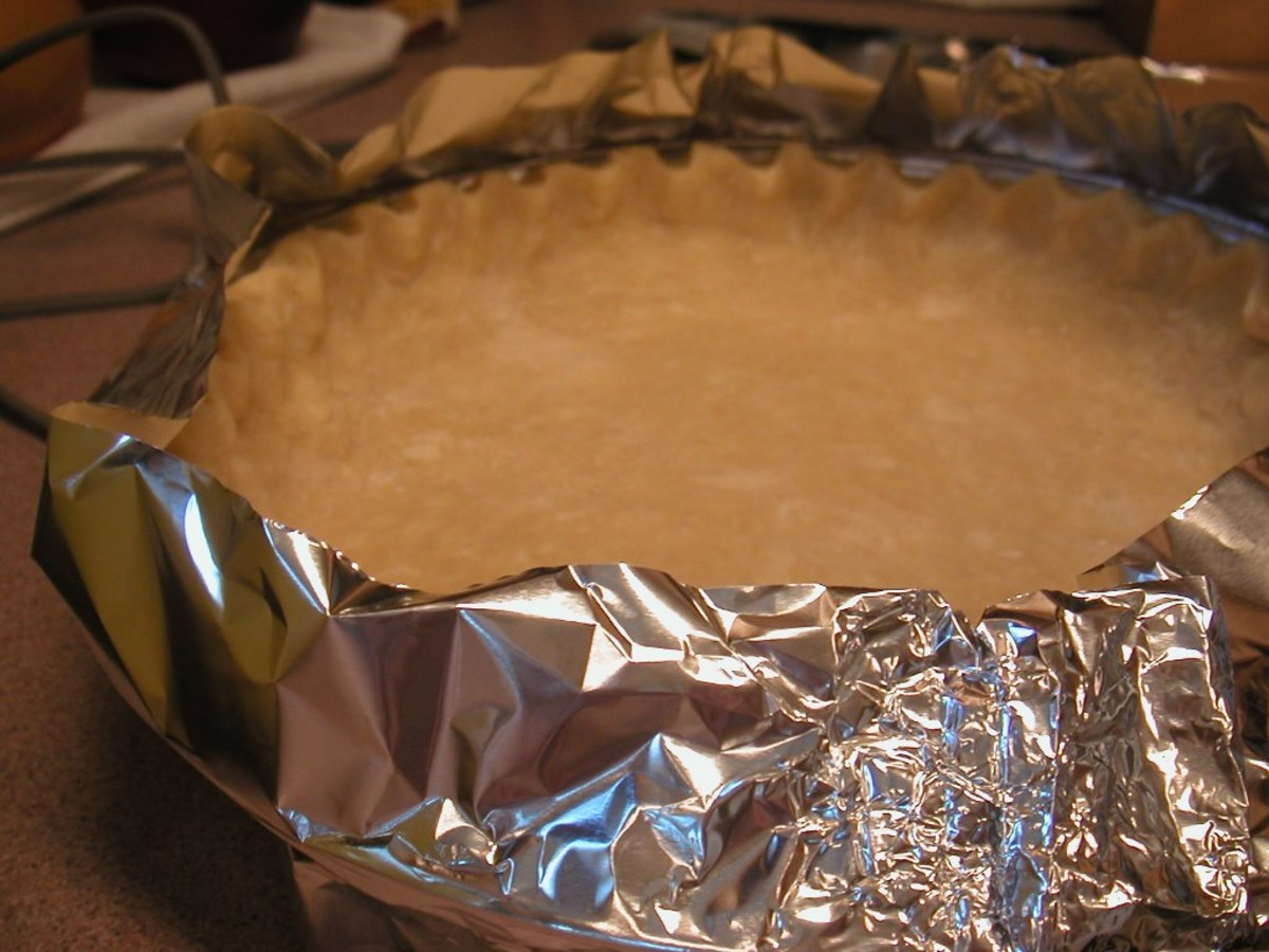 Wrap the outer edge of the crust to keep it from over-browning.