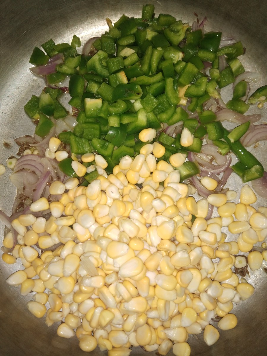 Add sweet corn and bell pepper.