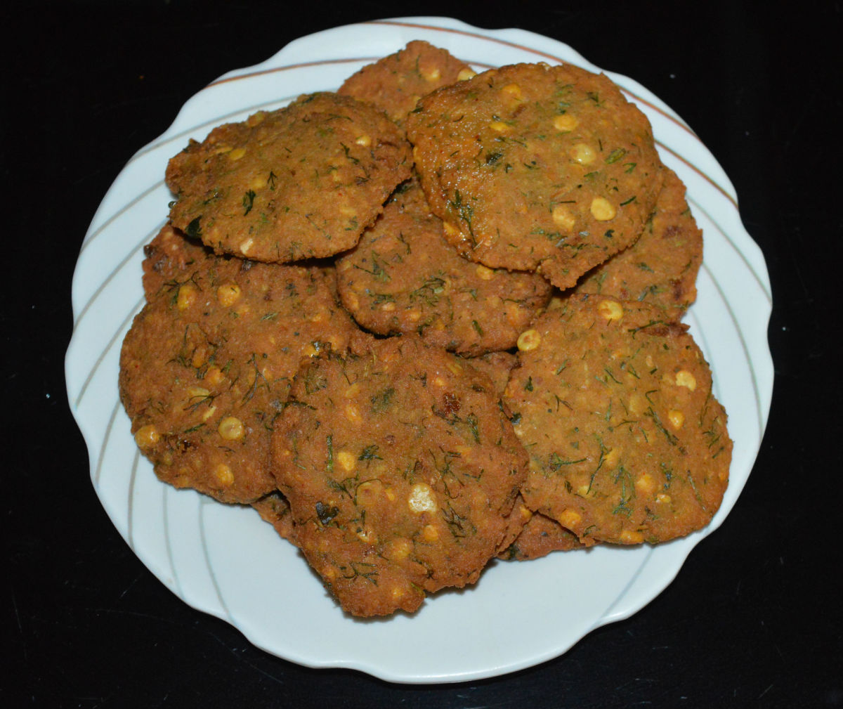 Masala vada are extremely delicious and flavorful. They retain their taste even when they become cold. They have all the goodness of chickpeas, herbs, and spices.