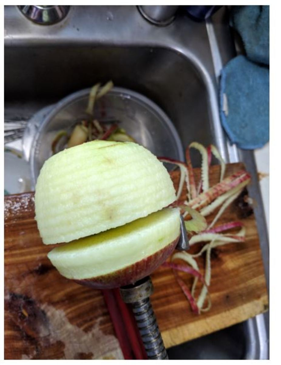 apple gets peeled and sliced and cored in one easy swoop