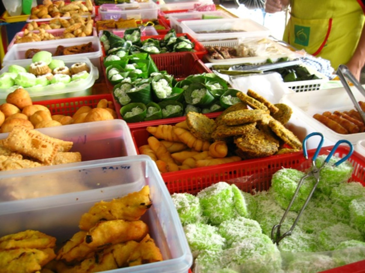 Local desserts and cakes on display at a Malaysian pasar malam (night market).