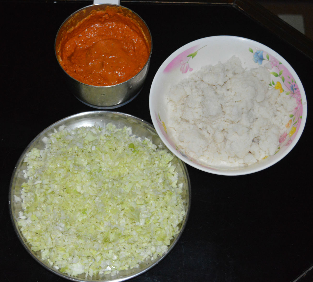 Step 3: Add the finely chopped cabbage, washed rice semolina, and salt to the bowl containing the paste.