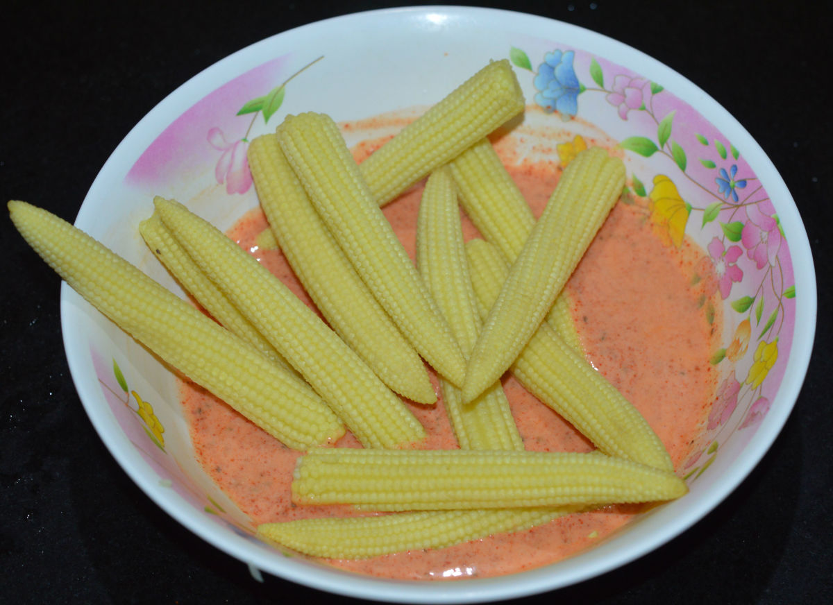 Step 2: Add the parboiled baby corn to the marinade. Toss well and set aside for 15 to 20 minutes.