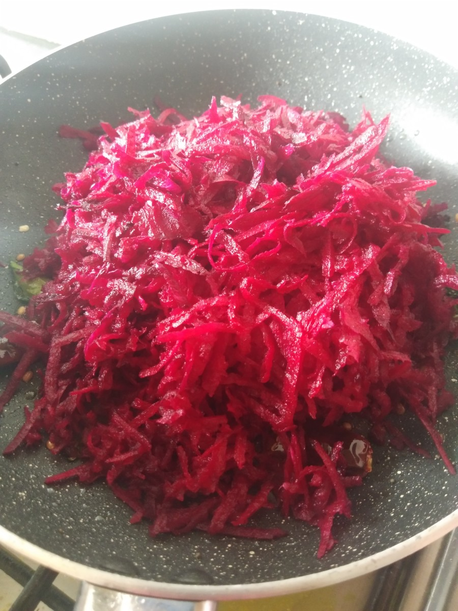 Add grated beetroot. Fry for 1 to 2 minutes over medium flame.