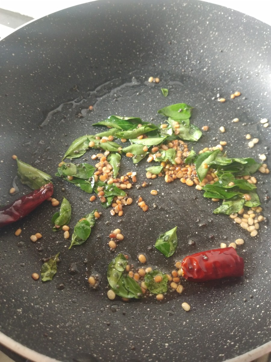 Add curry leaves and broken red chilies. Fry.