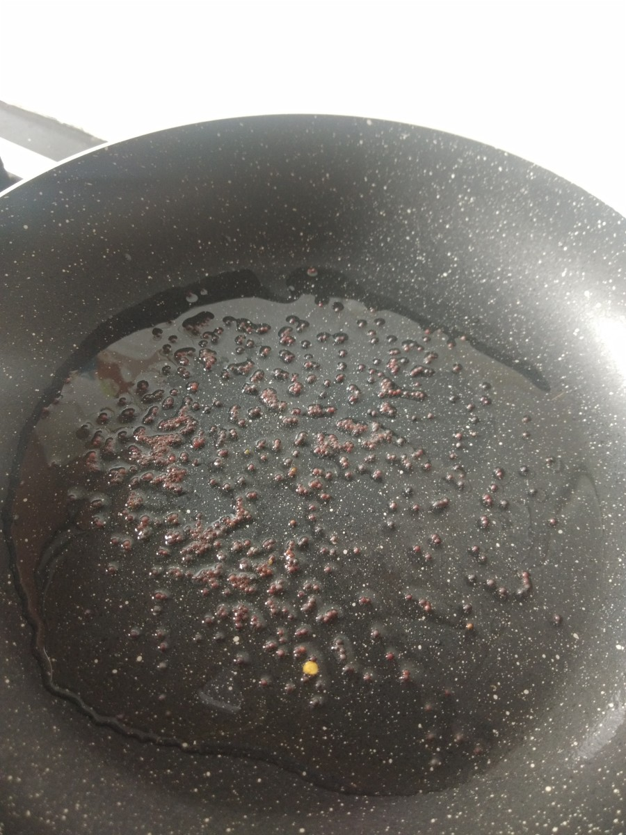 In a pan, heat oil or ghee, add mustard seeds, and let them splutter.