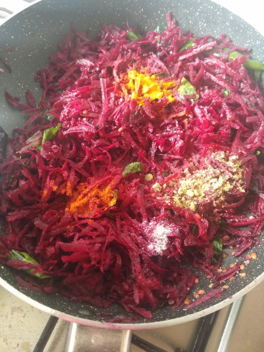 Add turmeric powder, red chili powder, coriander powder, and salt.