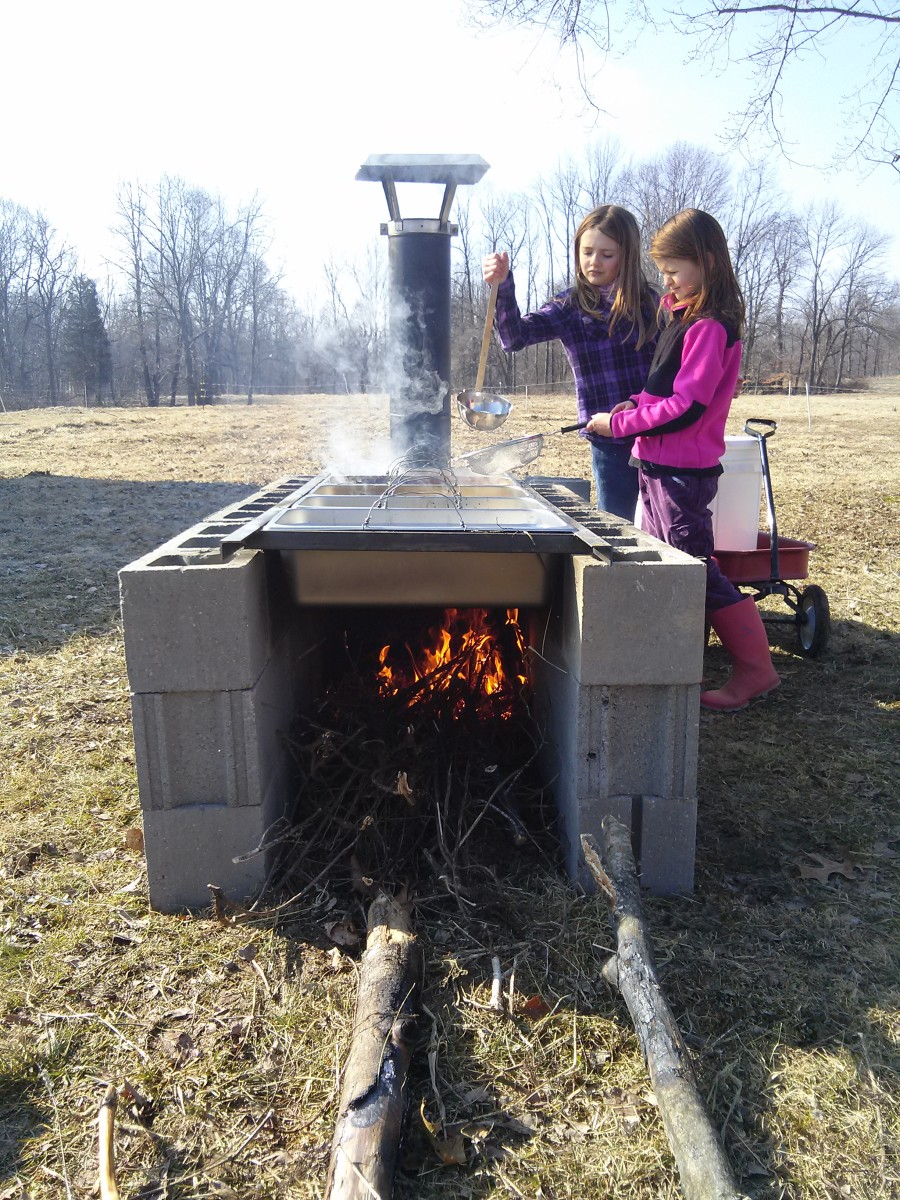 Moving the sap from pan to pan to help the evaporation process along.