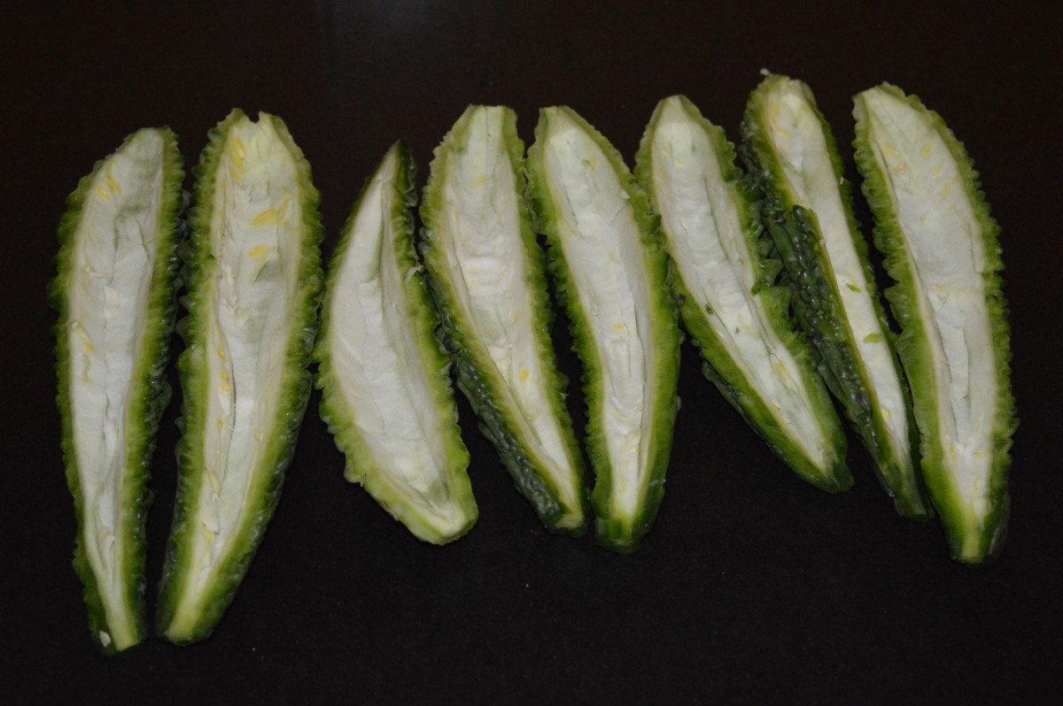 Step 1: Wash bitter gourd. Slit them and take out the seeds.
