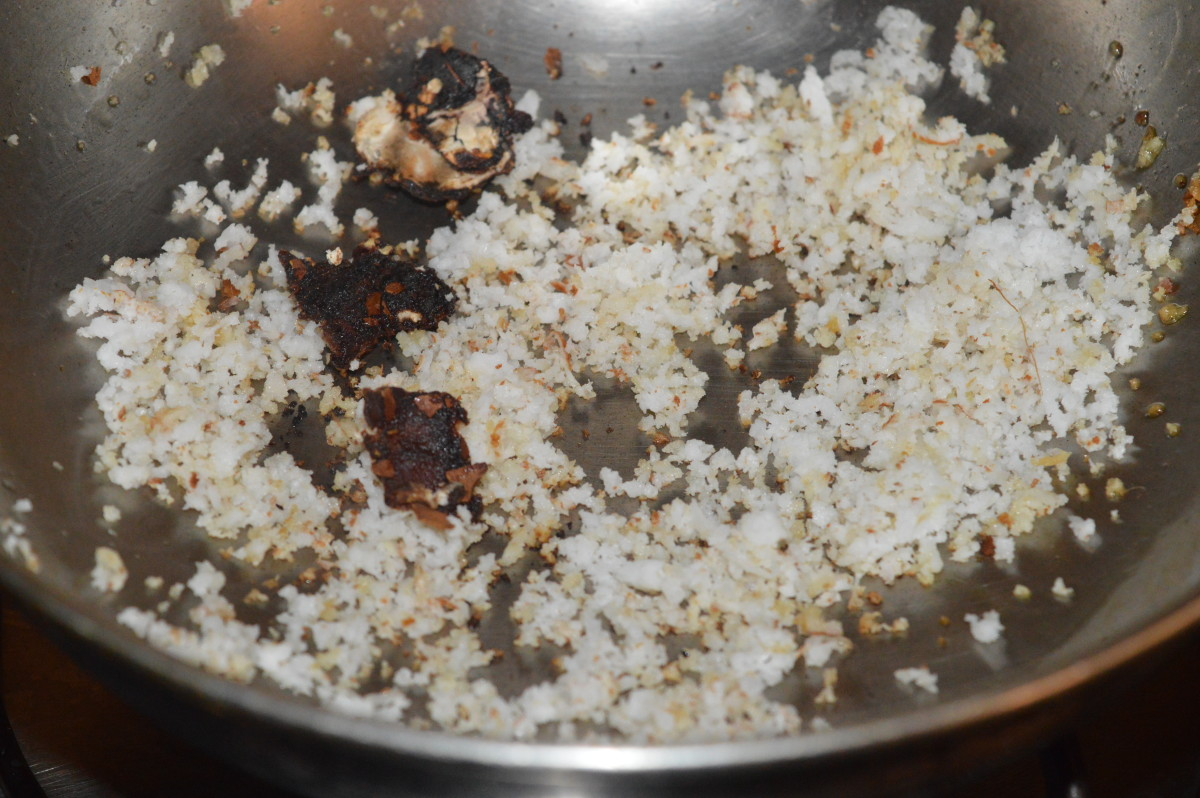 Add grated coconut and tamarind. Saute for a few seconds. Turn off the heat. Allow it to cool.